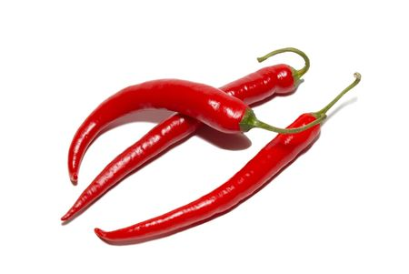 hottest: Red hot chili peppers isolated on white. Stock Photo