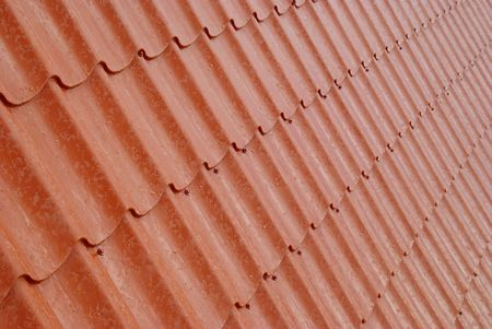 Wall of textured red tile. photo