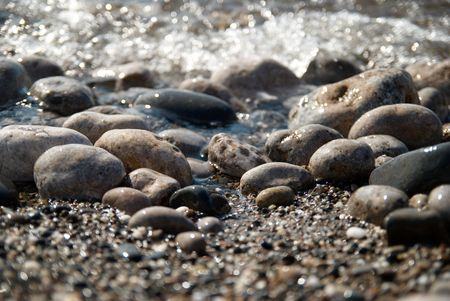 roaring sea: Rocks in the waves and sea foam. Stock Photo