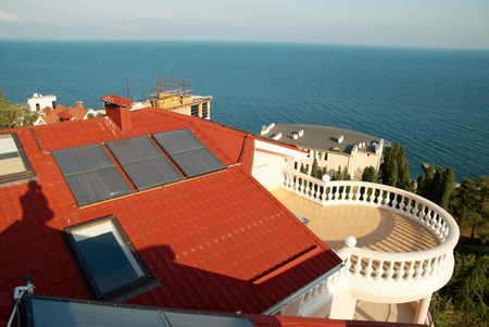 Alternative energy- solar system on the house roof. Stock Photo - 3849705