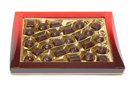 Sorted chocolate candies box isolated on white. photo