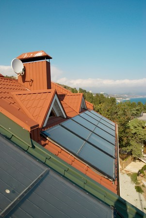 Alternative energy- solar system on the house roof. photo