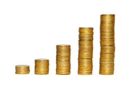 Columns of golden coins isolated on white. Stock Photo