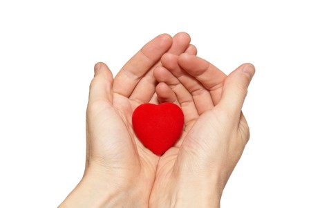 Small valentine heart in a hands. photo