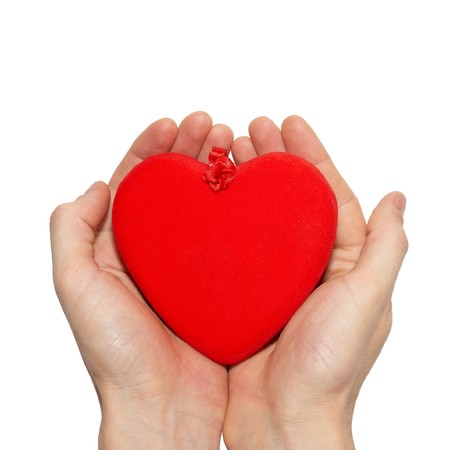 Big valentine heart in a hands. photo