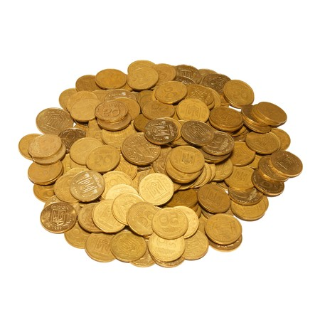 Heap of golden coins isolated on white. photo