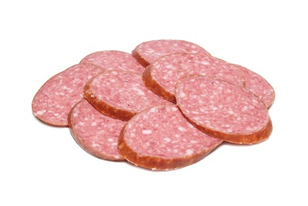 Heap of sliced sausage isolated on white photo