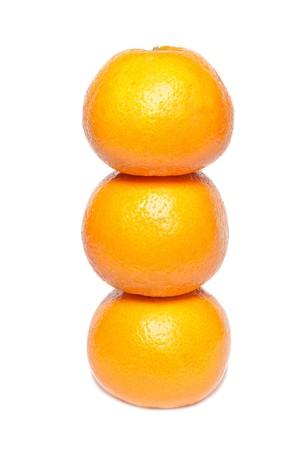 Row of orange mandarins isolated on white. photo
