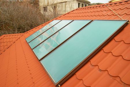 gelio: Solar water heating system (geliosystem) on the red house roof.