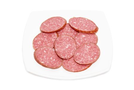 Sliced sausage with plate isolated on white photo