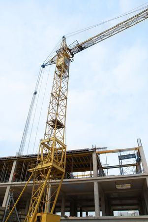 Building crane with the blue sky background