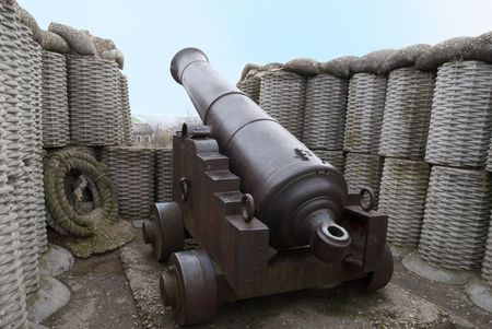 fortification: Retro black melal gun in the fortification Stock Photo