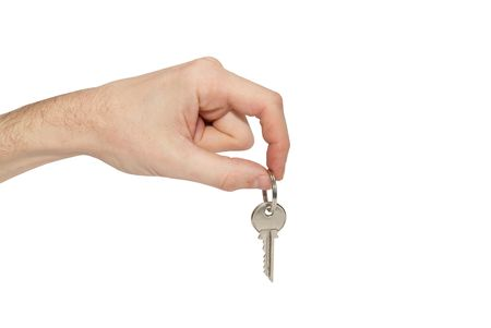 Key in the hand isolated on white photo