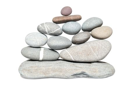 Wall of gray pebbles isolated on white  photo