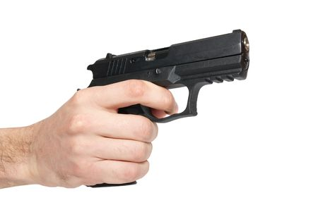 Black gun in a hand isolated on white photo
