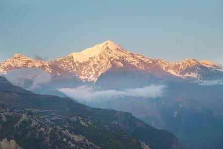 Sunrise at the mountain Annapurna South, Nepal photo