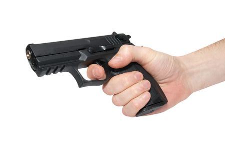 Black gun in a hand isolated on white Stock Photo - 4908345