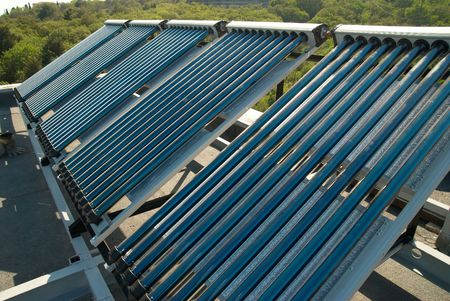 Vacuum solar water heating system on the house roof. Stock Photo - 5185155