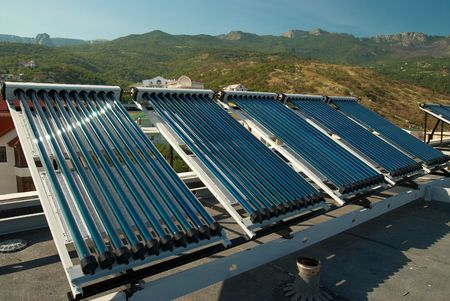voltaic: Vacuum solar water heating system on the house roof.