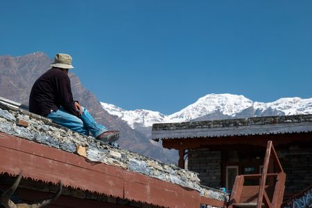 Tibetan village in Himalayan mountain with blue sky.  photo