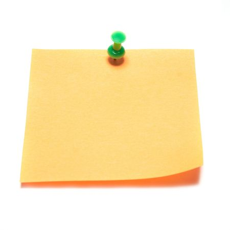 Orange note with tack isolated on white photo