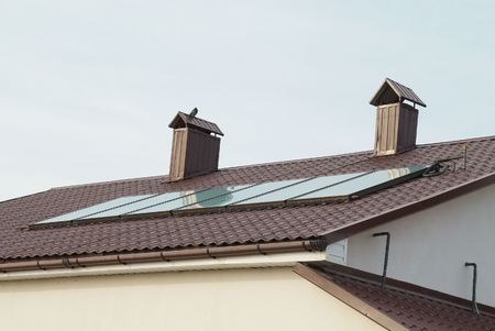 fuel cell: Solar panel (geliosystem) on the house roof. Stock Photo