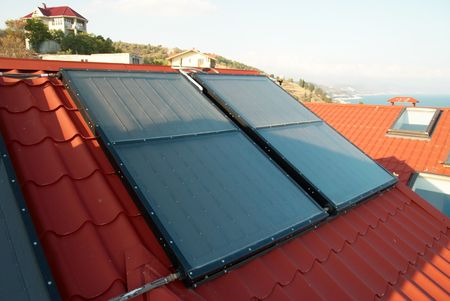 Alternative energy- solar system on the house roof. Stock Photo - 5282255