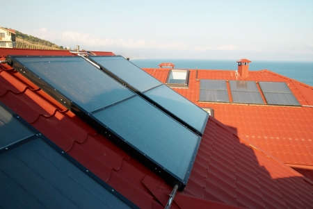 Alternative energy- solar system on the house roof. photo