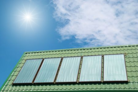 voltaic: Solar water heating system on the roof.