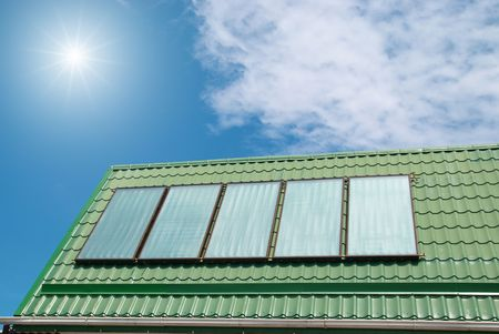 Solar water heating system on the roof. photo