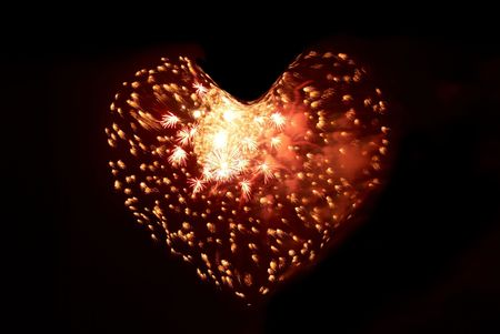 Heart from fireworks on the black sky background photo