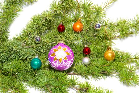 �hristmas baubles, fir tree and decoration isolated on white photo