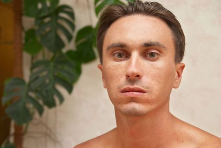 Portrait of caucasian man in the interior background  photo