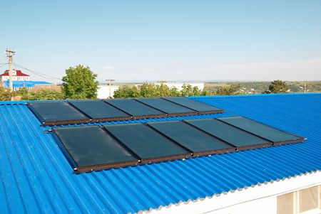gelio: Solar water heating system on the house roof. Stock Photo