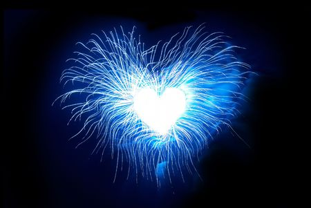 colorful light display: Heart from fireworks on the black sky background