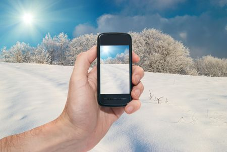 Winter mobile landscape with bright shining day photo