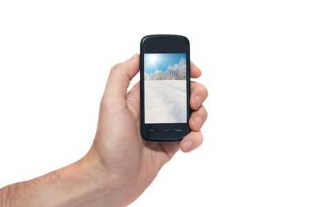 Mobile phone in the hand isolated on white Stock Photo - 5700323