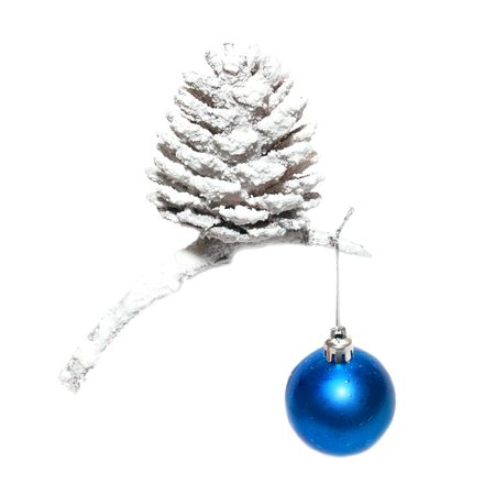 Christmas snow cone with blue bauble isolated on white. photo