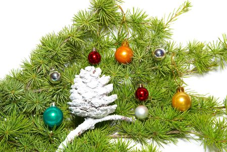 Christmas baubles, fir tree and decoration isolated on white photo