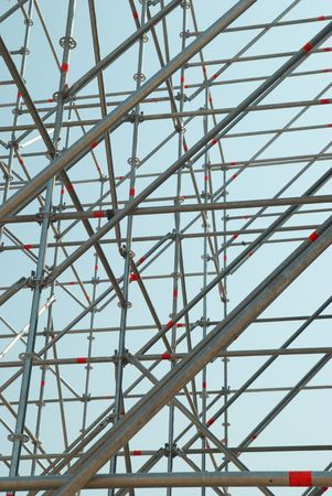 secure growth: Part of the construction scaffold with blue background