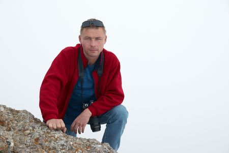 Man gesturing on the rock with white background Stock Photo - 6038671