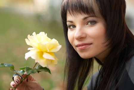 Beautiful girl with yellow rose, soft background Stock Photo - 6113598