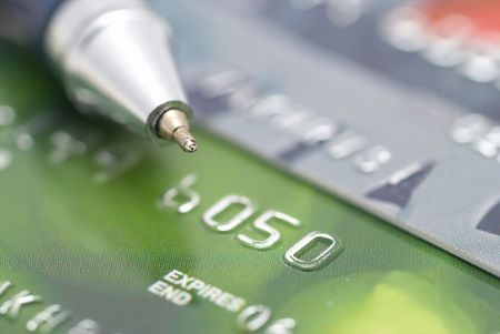 Credit cards with pen- concept finance background photo