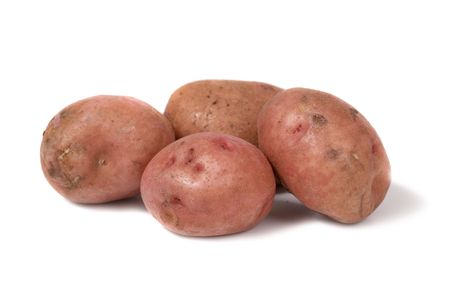 Stack of potatoes isolated on white background photo