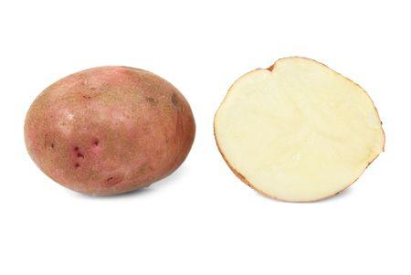 Potato and potatos half isolated on white background photo
