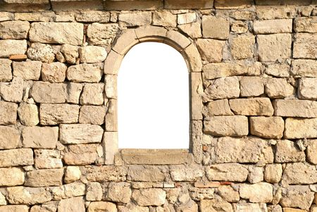 the architecture is ancient: Window in the ancient stone wall white isolated