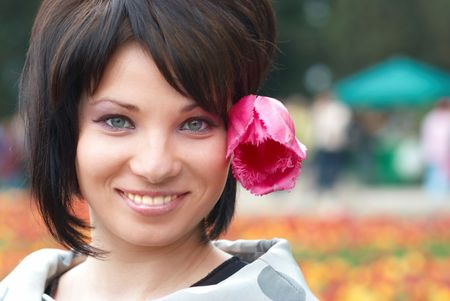 Pretty girl with tulips with soft background photo