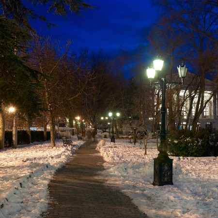 City night scene with lights and snow photo