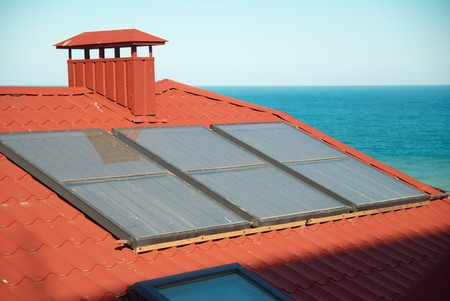 Solar system on the red house roof Stock Photo - 7068904