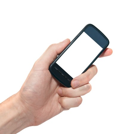 Mobile phone in the hand isolated on white Stock Photo - 7140422